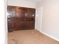 Bedroom with built-in cabinet